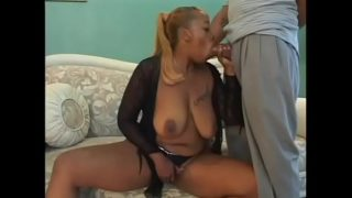 Black MILF Akara Richards with huge tits gets nailed doggy style on the sofa
